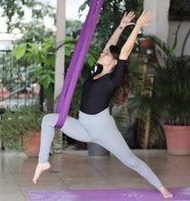aerial yoga swing poses warrior one