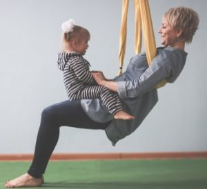 Aerial Yoga Provides Stress Relief for Parents